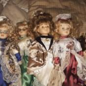 Value of Ashley Belle Porcelain Dolls- 5 dolls in fancy clothing