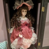 Identifying an Ashley Bell Doll - doll in display box, she has long ringlets and a salmon colored dress with matching hat