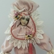 Value of Show Stoppers Porcelain Dolls - doll wearing an elaborate pink dress and headpiece