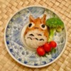 Totoro Inari Sushi Edible Craft - sushi on a plate with a piece of broccoli and three tomatoes