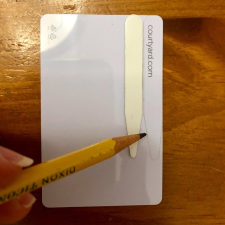 DIY Shirt Collar Stays from Magnetic Hotel Keys  - use a pencil to trace around the stay