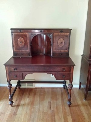Value of an Antique Lady's Writing Desk - inlay desk with alcove, side storage and small drawers plus a long front drawer and two more little ones