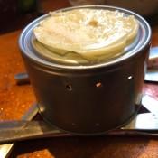 Making Pancakes On a Tin Can - pancake on can top