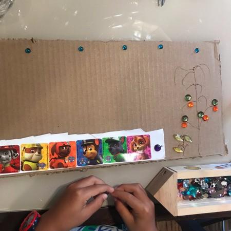 Children's artwork on recycled cardboard.