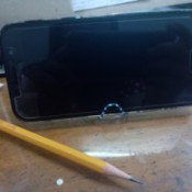 Making a Paper Clip Phone Stand - phone on stand with pencil next to it