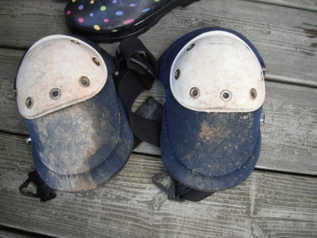 Muddy knee pads for use in gardening.