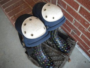 Knee pads on top of rubber boots for garden work.