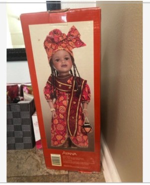 Value of a Limited Edition Ayana Porcelain Doll - doll in a box, wearing a long dress and matching head dress