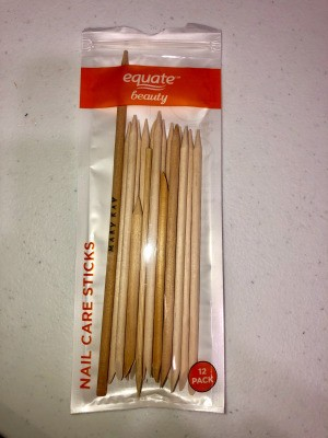 A package of cuticle sticks with one made from a bamboo skewer.