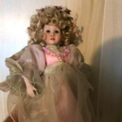Identifying a Porcelain Doll - doll with a mass of blond ringlets and fancy dress