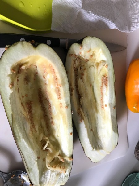 scraping out Eggplant halves