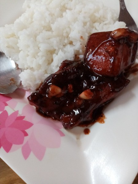 Pork Belly and Ribs in Barbecue Sauce on plate with rice