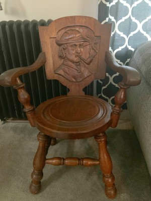 Identifying an Antique Chair - old chair with a carving of the bust of a man wearing a hat and smoking a pipe