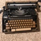 Repairing a Smith Corona Typewriter - black manual typewriter