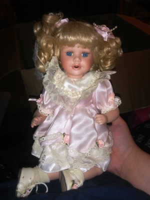 Value of Heritage Signature Collection Dolls - doll with curly blonde hair wearing a white satin dress