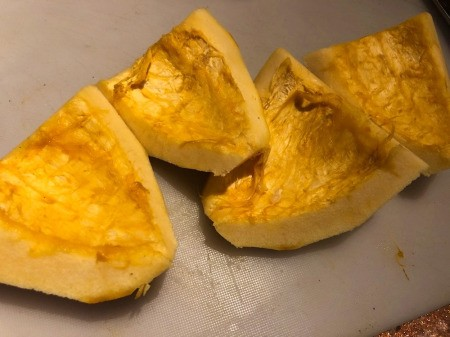 Acorn Squash peeled, seeds removed in quarters