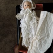 Value of a Brinn Baby Doll - doll in a long christening style dress and bonnet