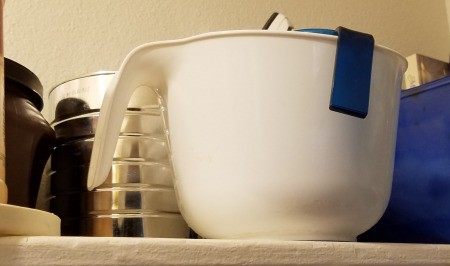 Mixing bowl stacked so that both handles show.