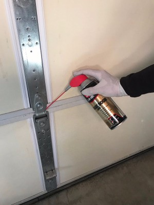 Lubricating a garage door.