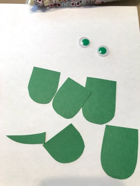 Personalized Turtle Wall Art Using Old Art - cut out legs, a tail, and a head from green construction paper