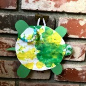 Personalized Turtle Wall Art Using Old Art - turtle artwork hangin on a brick wall, pr