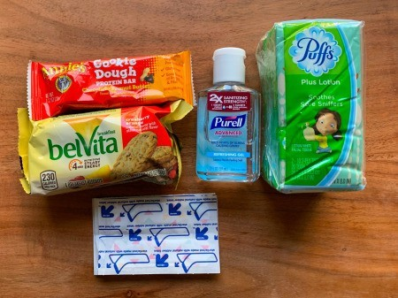 The supplies stored in a backpack emergency kit.