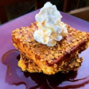 Cornflake Crusted Cinnamon French Toast with whipped cream & syrup