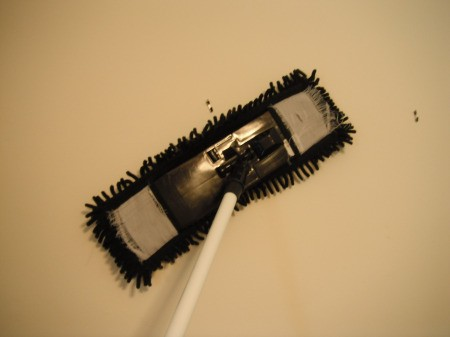 Cleaning a Bedroom By Yourself -dusting walls with a microfiber swivel mop