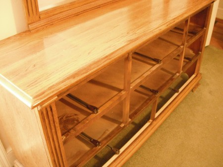 Cleaning a Bedroom By Yourself - drawers removed from dresser for cleaning inside and moving to clean floor and wall