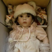 Value of Seymour Mann and Marie Osmond Dolls - doll in box wearing a pink dress