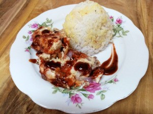 Chicken Egg Roll on plate with rice