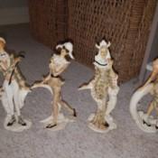 Identifying Figurines - four costumed figurines