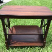 Value of a Brandt Site Table - rectangular table with decorative sides and slanted lower shelf