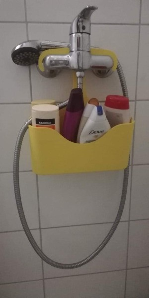 A shower buddy to store shampoo and bath supplies.