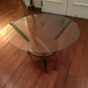Value of a Vintage Round Glass Topped Table - round glass topped table with wood base including a shelf and three legs