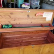 Value of a Lane Cedar Chest - chest open to show that there is a scissor action shallow compartment that operates with the lid