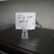 A note placed inside a recycled hangar clip.