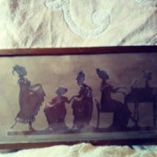 Identifying Framed Paper Cutout Silhouettes - woman playing a piano and others bowing and dancing