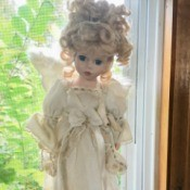 Identifying a Porcelain Doll - doll with wings