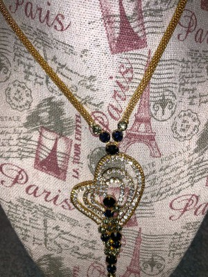 A heart shape costume jewelry necklace.