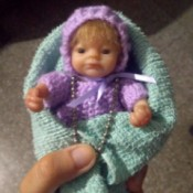 Value of an Ashton Drake Mini Baby Doll - small doll in crochet outfit