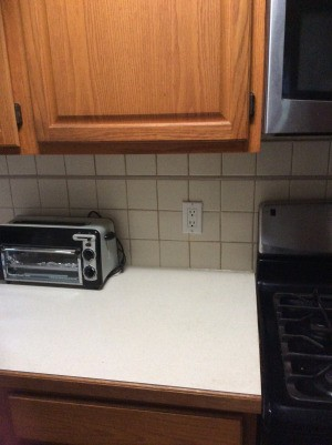 Choosing a Kitchen Paint Color - countertop, tile and cabinet view