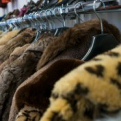 A row of faux fur jackets.