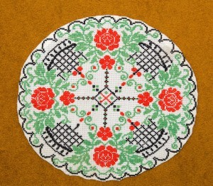 A colorful cross stitched circle.