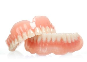 A pair of dentures on a white background.