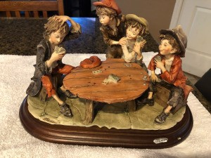 Value of a Giuseppe Armani Capodimonte Figurine - kids playing cards around a round table