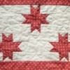 A red and white quilt.