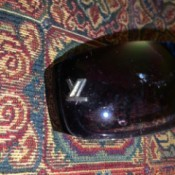 Identifying the Brand on a Pair of Sunglasses - gray or silver logo near the hinge