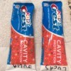 Two tubes of toothpaste with names marked on them.