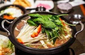 A Korean hot pot on a table.